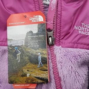5702ae499860 North Face One Pieces